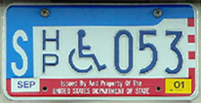 1984 base OFM Diplomatic Staff handicapped person license plate no. 053