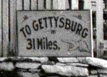 Close image of road sign identifying the road and distance to Gettysburg, Pa.