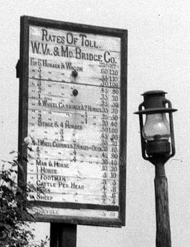 Toll schedule posted at a Potomac River bridge, Sept. 1910.