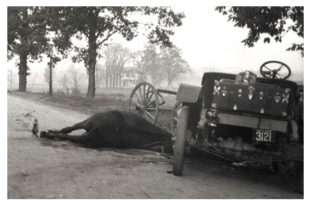 Scene of collision between horse-drawn and horseless carriages