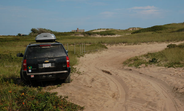 D.C. auto plate no. DK-0244 on a Chevrolet Suburban parked at Ladies Beach on Nantucket, Mass.